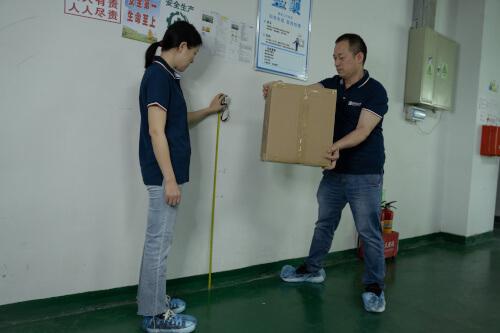 Product quality inspectors conducting a carton drop test
