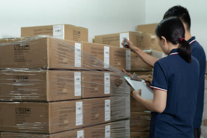 Inspectors selecting cartons for third-party inspection