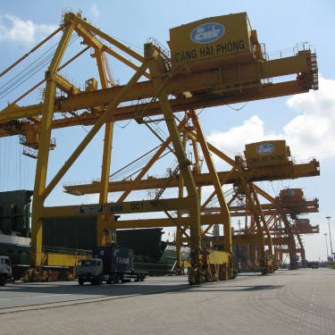 Shipping container atop crane