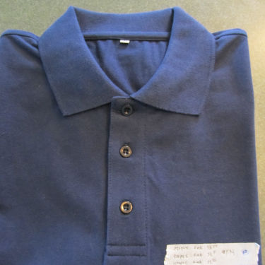 Blue polo shirt ready for garment inspection procedures