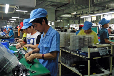 Factory workers inside electronics factory
