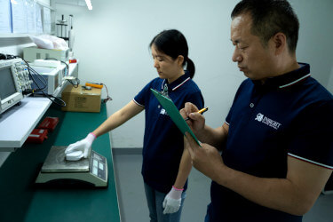 Two product inspectors conducting a third-party inspection