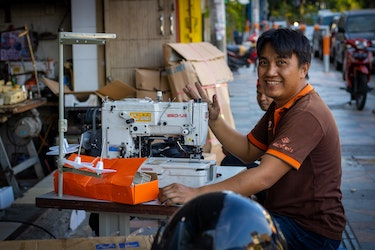 Indonesian man with a sewing machin
