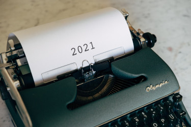 A typewriter with a paper that says 2021 coming out of it