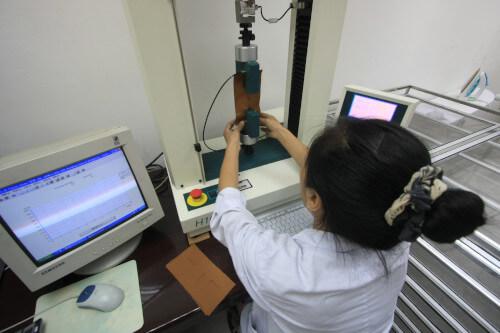 Laboratory technician testing fabrics