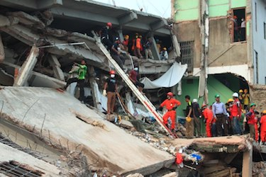 Rescue workers at collapsed building