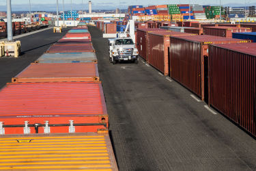 CBP truck driving by containers at port