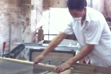 Factory worker working with wood