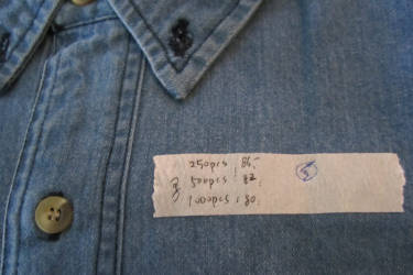 Jean shirt with quality inspection sticker