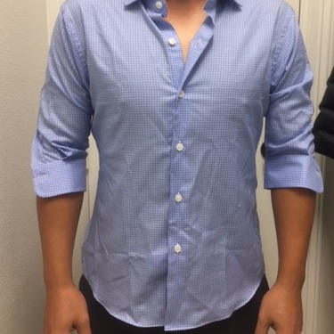 Dress shirt with sleeves half as long as they should be