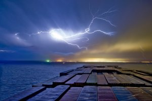 Container ship on the ocean during a storm