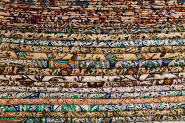 Various Middle Eastern fabrics stacked on top of eachother