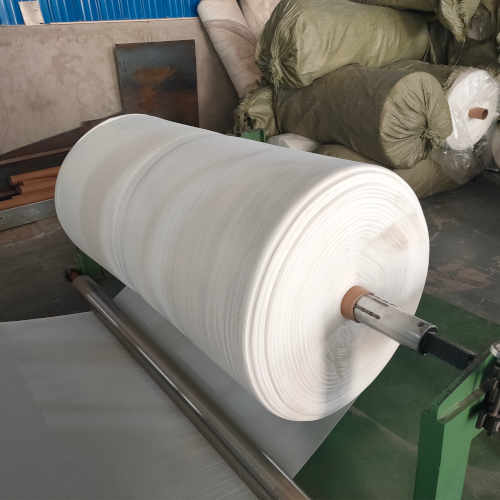 Spool of material inside a yoga mat factory