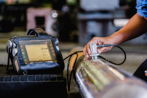 Ultrasonic test being performed on incoming materials