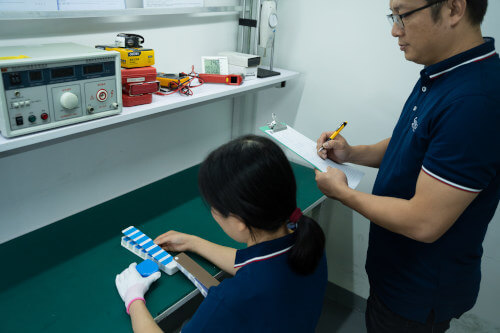 Inspectors using quality checklist to record color verification results