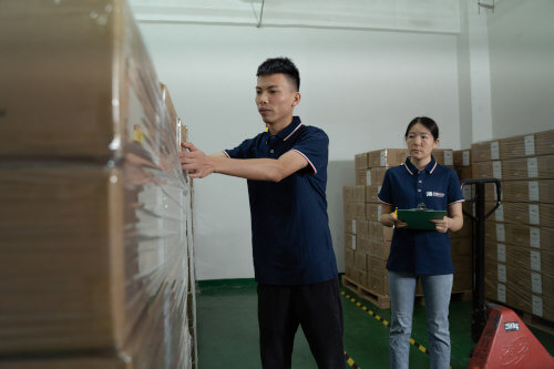Insight product inspectors pulling cartons for inspection
