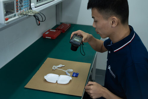 Product inspector photographing a tooth whitening kit during inspection